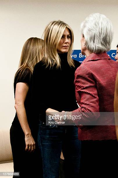 Jennifer Aniston and Kathleen Sebelius speak during a roundtable discussion during a visit to the Breast Care Center at the Inova Alexandria Hospital...