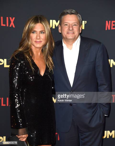 Jennifer Aniston and Ted Sarandos arrives at the premiere of Netflix's 'Dumplin'' at the Chinese Theater on December 6 2018 in Los Angeles California