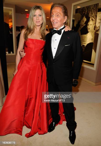 Jennifer Aniston and Valentino Garavani attend the 2013 Vanity Fair Oscar Party hosted by Graydon Carter at Sunset Tower on February 24 2013 in West...