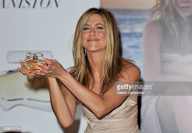 Jennifer Aniston attends photocall at the launch of her debut fragrance at Harrods on July 21 2010 in London England