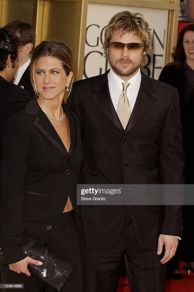 Jennifer Aniston & Brad Pitt arrive at the Golden Globe Awards at the Beverly Hilton January 20, 2002 in Beverly Hills, California. Brad Pitt wearing Burberry 8933S sunglasses.