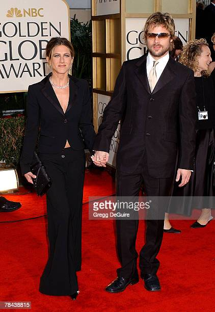 Jennifer Aniston Brad Pitt arrive at the Golden Globe Awards at the Beverly Hilton January 20 2002 in Beverly Hills California Brad Pitt is wearing...