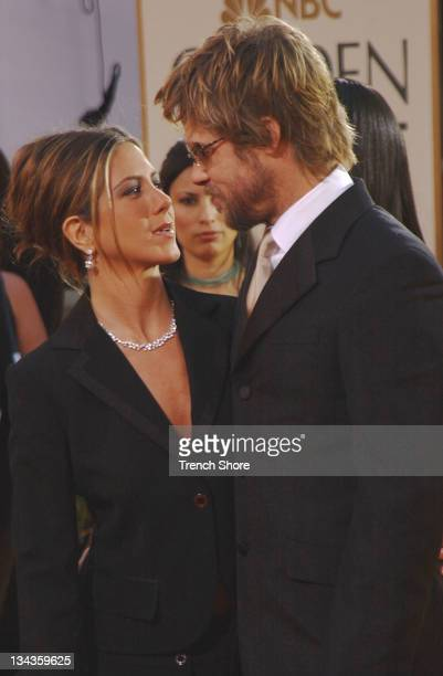 Jennifer Aniston Brad Pitt at the Golden Globe Awards at the Beverly Hilton January 20 2002 in Beverly Hills California Brad Pitt is wearing Burberry...