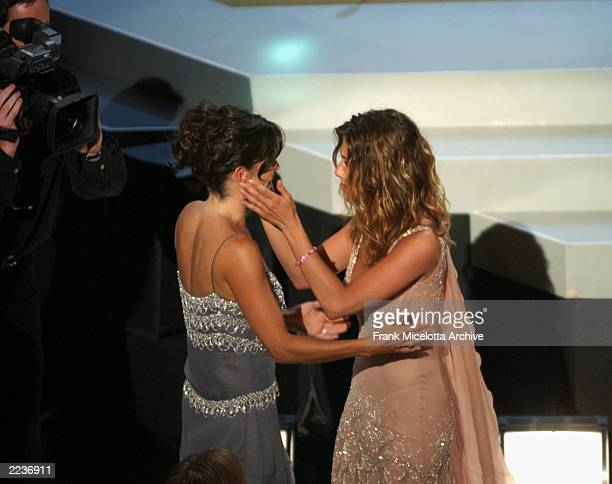 Jennifer Aniston congratulates her costar Courteney Cox prior to going onstage to accept their Emmy for Outstanding Comedy Series during the 54th...