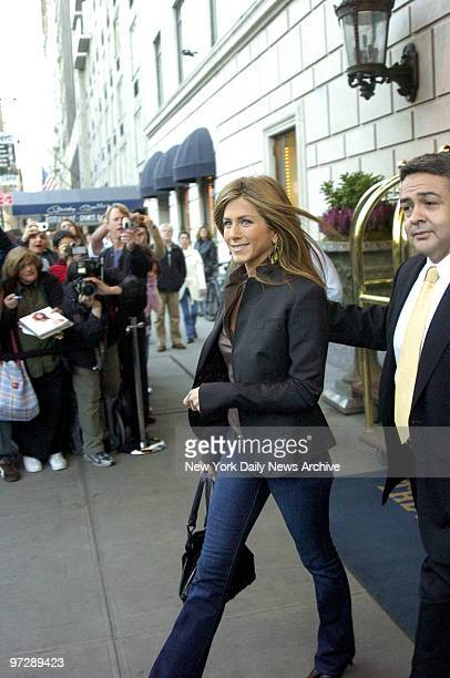 Jennifer Aniston leaves the Ritz Carlton hotel on her way to MTV studios to make an appearance on Total Request Live