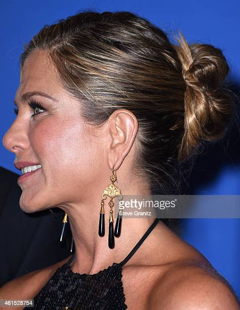 Jennifer Aniston poses in the 72nd Annual Golden Globe Awards at The Beverly Hilton Hotel on January 11 2015 in Beverly Hills California
