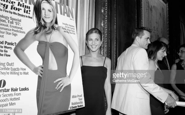 Jennifer Aniston poses with a blowup of her cover of Cosmopolitan Magazine at a party in 1997 in New York City New York