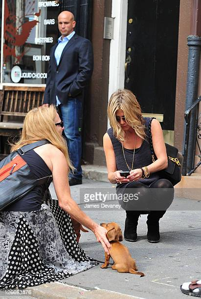 Jennifer Aniston takes pictures of a puppy in the West Village on September 26 2011 in New York City