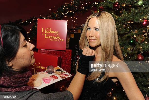 Jennifer Aniston warms up winter at Madame Tussausds New York at Madame Tussauds on December 13 2012 in New York City
