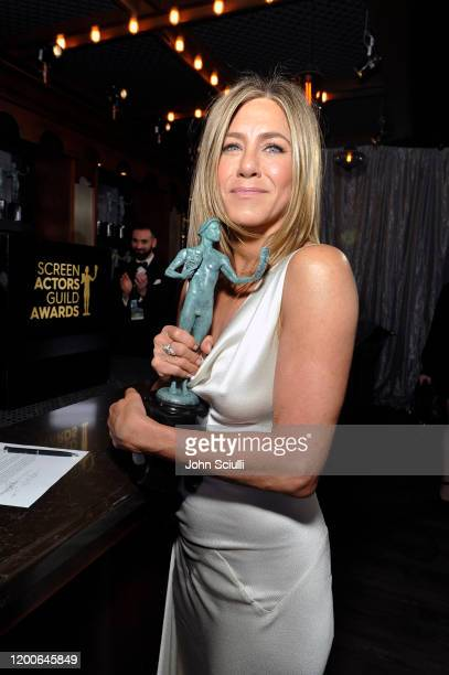 Jennifer Aniston, winner of Outstanding Performance by a Female Actor in a Drama Series for 'The Morning Show', poses in the trophy room during the...