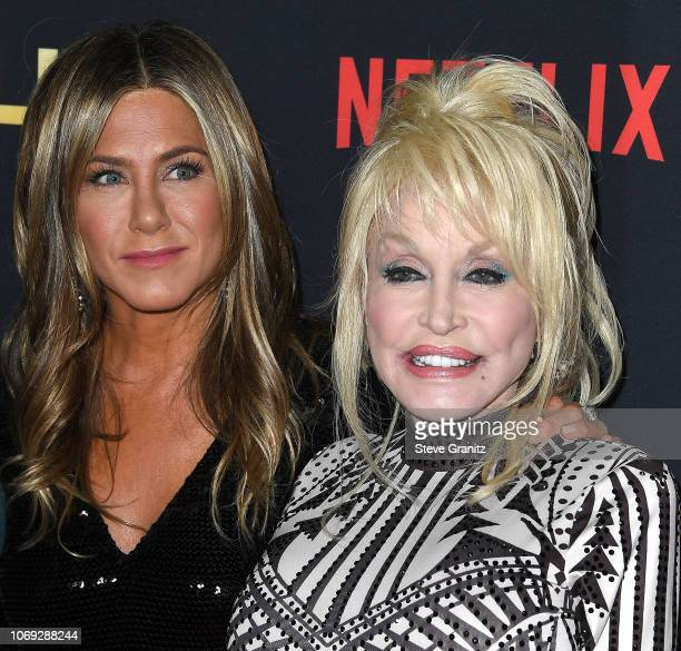 Jennifer AnistonDolly Parton arrives at the Premiere Of Netflix's 'Dumplin'' at TCL Chinese 6 Theatres on December 6 2018 in Hollywood California