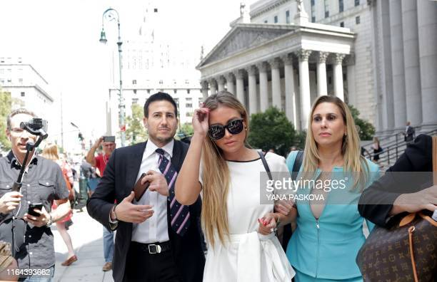 Jennifer Araoz , one of deceased financier Jeffrey Epstein's alleged victims, and her attorney Kimberly Lerner , finish speaking to the press outside...