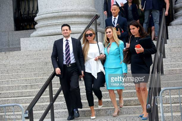Jennifer Araoz , one of deceased financier Jeffrey Epstein's alleged victims, and her attorney Kimberly Lerner , prepare to speak to the press...