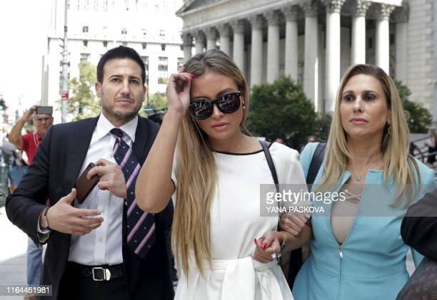 Jennifer Araoz one of deceased financier Jeffrey Epstein's alleged victims and her attorney Kimberly Lerner finish speaking to the press outside the...