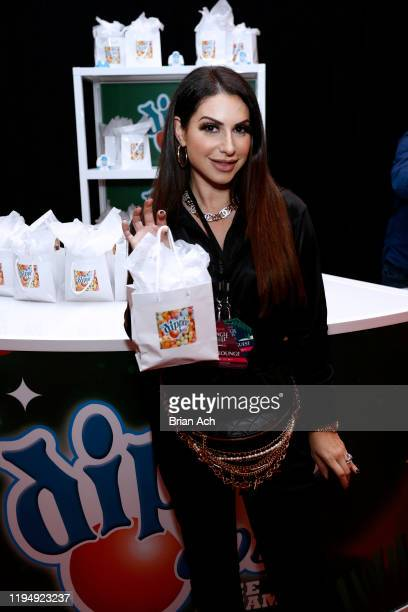 Jennifer Aydin poses with Dippin' Dots at the iHeartRadio's Z100 Jingle Ball 2019 Presented By Capital One - Gifting Lounge on December 13, 2019 in...