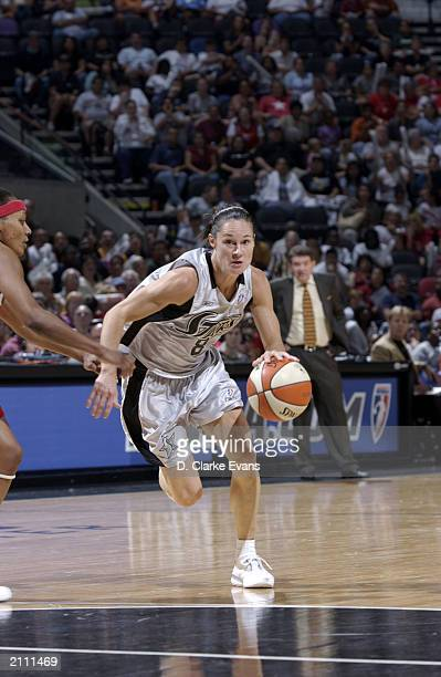 Jennifer Azzi of the San Antonio Silver Stars drives upcourt during the game against the Houston Comets at SBC Center on June 20 2003 in San Antonio...
