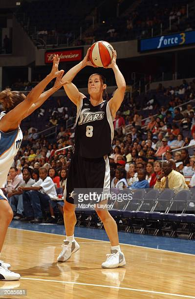 Jennifer Azzi of the San Antonio Silver Stars looks to pass from the freethrow line during the WNBA game against the Washington Mystics at MCI Center...