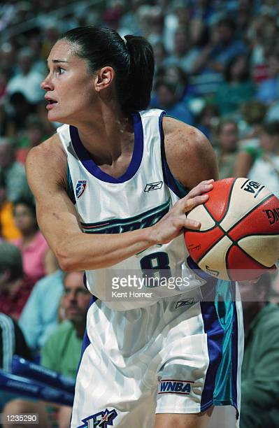 Jennifer Azzi of the Utah Starzz looks to pass during the game against the Phoenix Mercury on July 26 2002 at Delta Center in Salt Lake City Utah The...