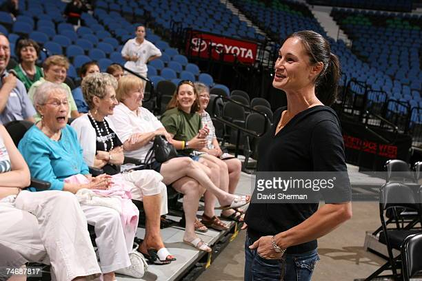 Jennifer Azzi Olympic gold medal winner and former WNBA player talks with season ticket holders prior to the game between the Minnesota Lynx and the...
