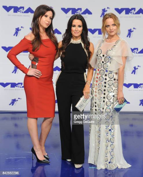 Jennifer Bartels Kyle Richards and Mena Suvari arrive at the 2017 MTV Video Music Awards at The Forum on August 27 2017 in Inglewood California