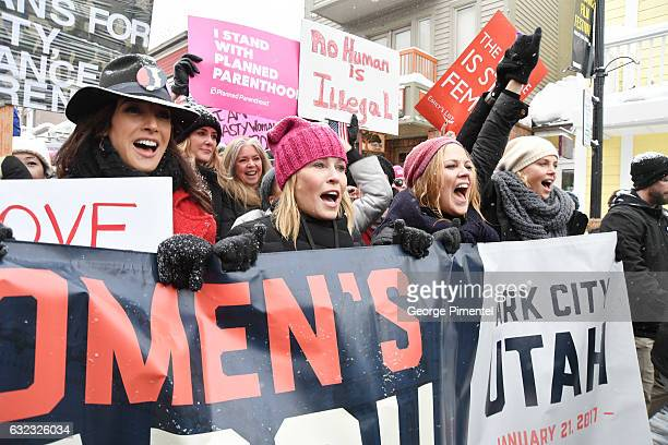 Jennifer Beals Chelsea Handler and Charlize Theron participates in the Women's March on Main Street Park City on January 21 2017 in Park City Utah