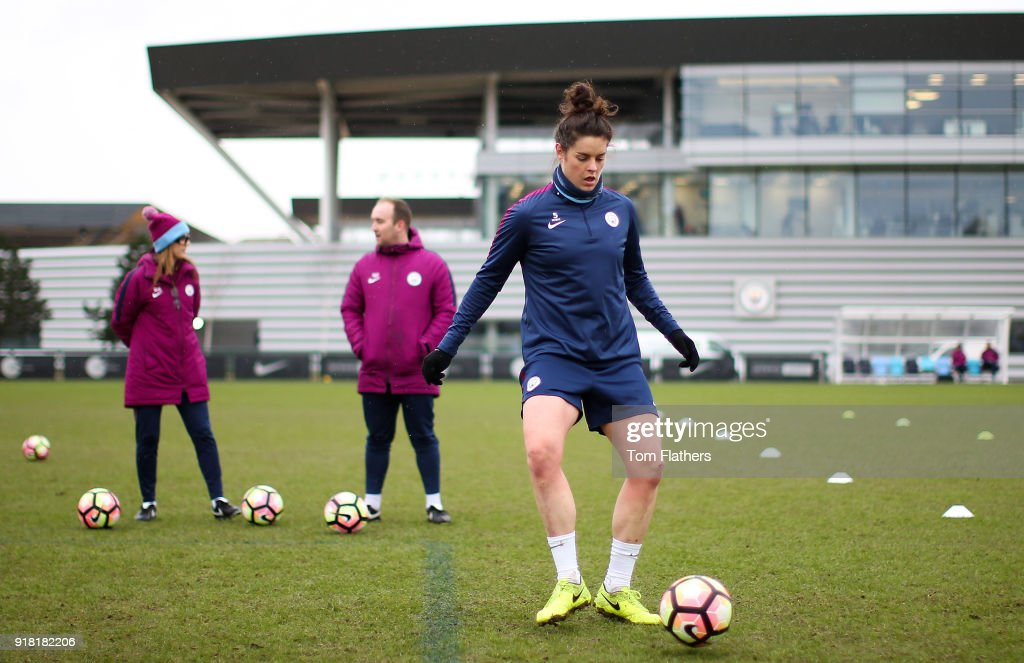 Jennifer Beattie is watched by manager Nick Cushing during training at Manchester City Football Academy on February 14, 2018 in Manchester, England.