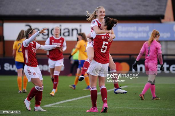 Jennifer Beattie of Arsenal celebrates with Jordan Nobbs and Leah Williamson after scoring their team's third goal during the Barclays FA Women's...
