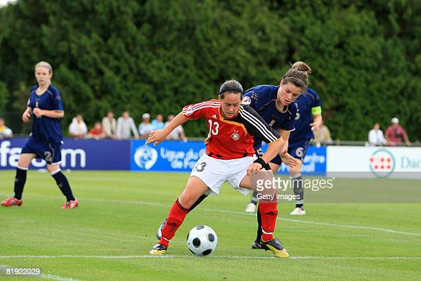 Jennifer Beattie of Scotland and Lisa Schwab of Germany fight for the ball during the Women's U19 European Championship match between Scotland and...
