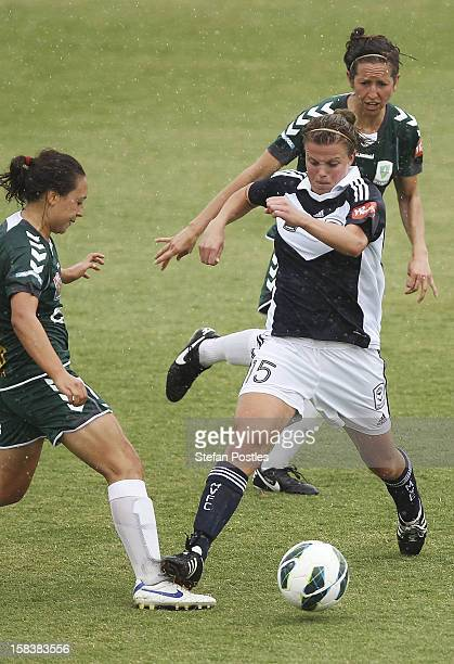 Jennifer Bisset of Canberra United and Amy Jackson of Melbourne Victory contest possession during the round nine W-League match between Canberra...