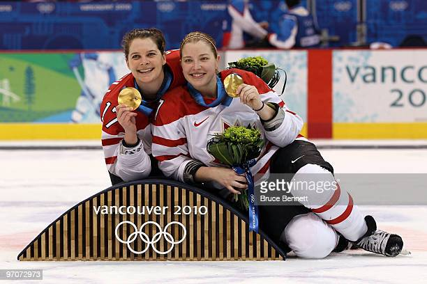 Jennifer Botterill and Cherie Piper of Canada pose with the gold medals following their team's 20 during the ice hockey women's gold medal game...