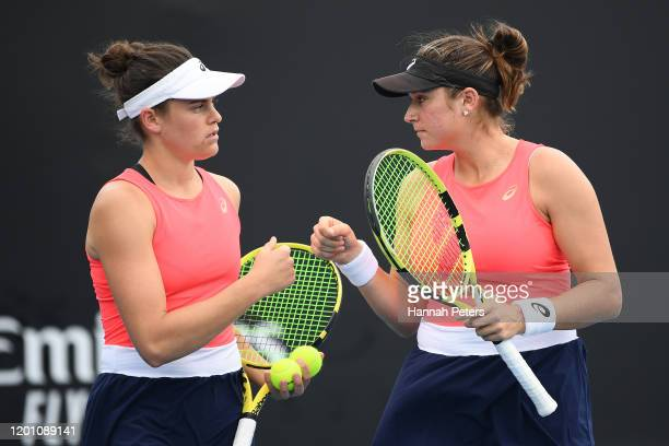 Jennifer Brady and Caroline Dolehide of the United States talk tactics during their Women's Doubles first round match against Nicole Melichar of the...