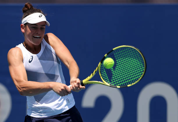 Jennifer Brady of Team USA plays a backhand during her Women's Singles First Round match against Camila Giorgi of Team Italy on day two of the Tokyo...