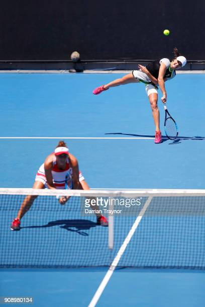 Jennifer Brady of the United States and Vania King of the United States compete in their women's doubles match against IrinaCamelia Begu of Romania...