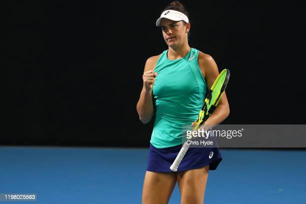 Jennifer Brady of the United States celebrates a point in her match against Maria Sharapova of Russia during day two of the 2020 Brisbane...