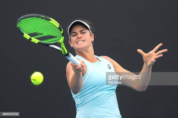 Jennifer Brady of the United States plays a forehand in her first round match against Magda Linette of Poland on day one of the 2018 Australian Open...