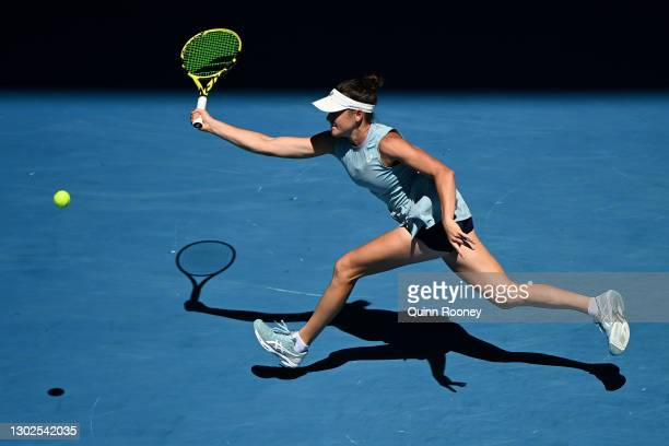 Jennifer Brady of the United States plays a forehand in her Women's Singles Quarterfinals match against Jessica Pegula of the United States during...