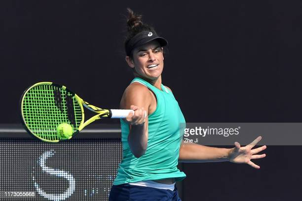 Jennifer Brady of the United States returns a shot against Madison Keys of the United States during the women's singles second round match of 2019...