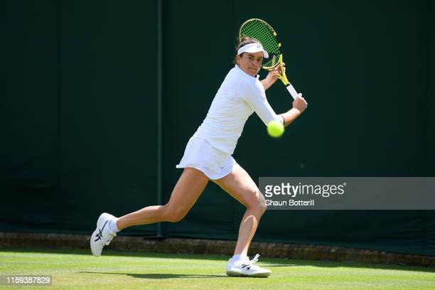 Jennifer Brady of The United States runs to play a backhand in her Ladies' Singles first round match against Petra Martic of Croatia during Day one...