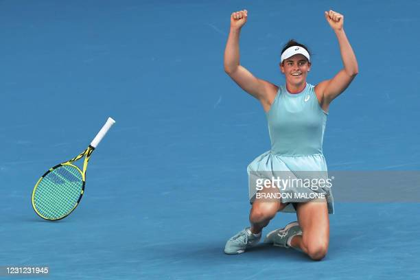 Jennifer Brady of the US celebrates beating Czech Republic's Karolina Muchova in their women's singles semi-final match on day eleven of the...