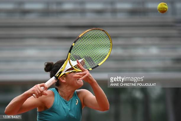 Jennifer Brady of the US returns the ball to Denmark Clara Tauson during their women's singles first round tennis match at the Simonne Mathieu court...