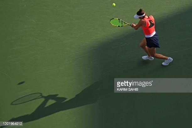 Jennifer Brady of the US returns the ball to Garbine Muguruza of Spain during the WTA Dubai Duty Free Tennis Championship, at the Dubai Tennis...