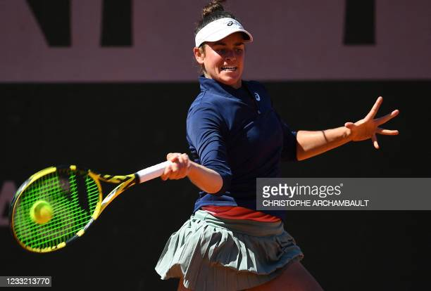 Jennifer Brady of the US returns the ball to Latvia's Anastasija Sevastova during their women's singles first round tennis match on Day 3 of The...