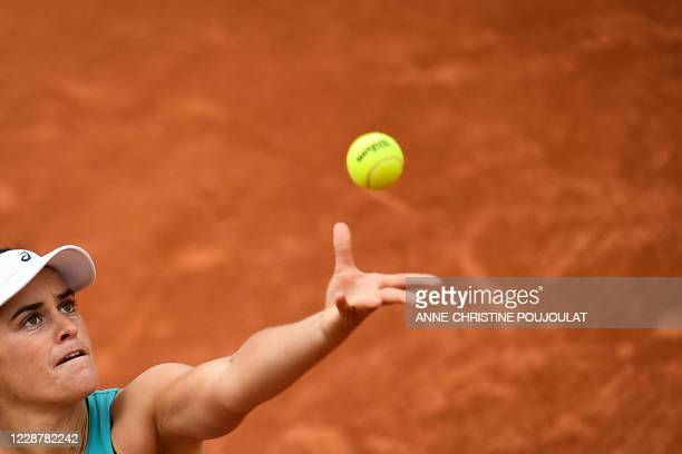 Jennifer Brady of the US serves the ball to Denmark Clara Tauson during their women's singles first round tennis match at the Simonne Mathieu court...