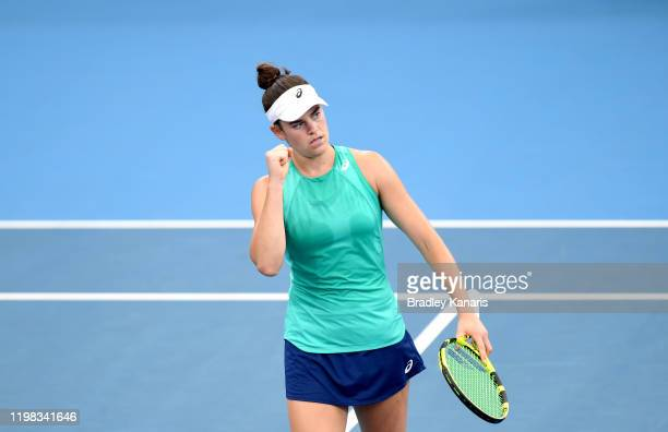 Jennifer Brady of the USA celebrates winning a point in her match against Ashleigh Barty of Australia during day four of the 2020 Brisbane...