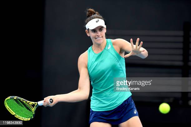 Jennifer Brady of the USA plays a forehand in her match against Ashleigh Barty of Australia during day four of the 2020 Brisbane International at Pat...