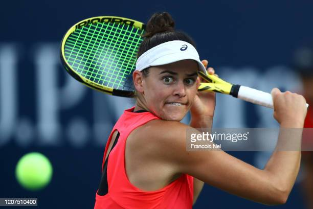 Jennifer Brady of USA plays a backhand against Garbine Muguruza of Spain during Day Four of the Dubai Duty Free Tennis at Dubai Duty Free Tennis...