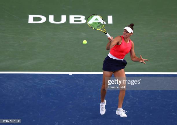 Jennifer Brady of USA plays a forehand against Garbine Muguruza of Spain during Day Four of the Dubai Duty Free Tennis at Dubai Duty Free Tennis...