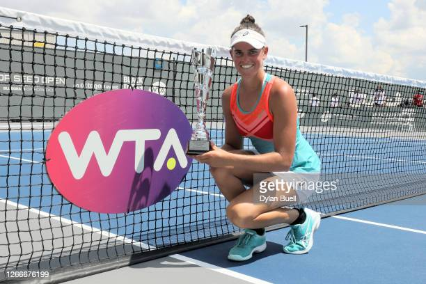 Jennifer Brady poses with the trophy after defeating Jil Teichmann of Switzerland 6-3, 6-4 to win the Top Seed Open at the Top Seed Tennis Club on...