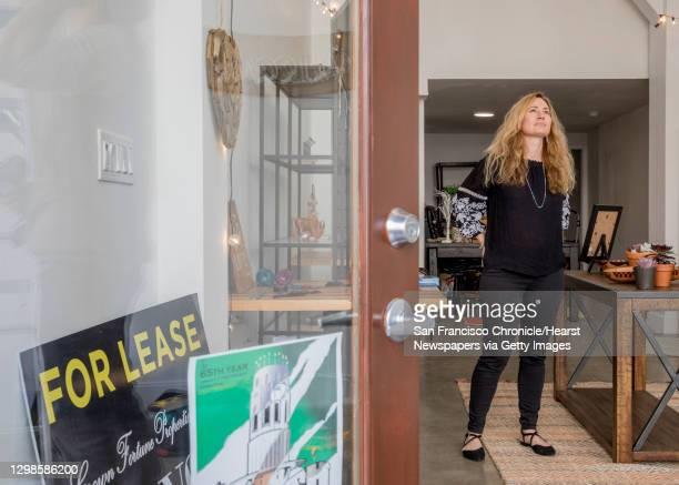 Jennifer Brisbin supervises as Nicholas Campanelli hangs a lamp inside her future Free Wheeling home decor store along Grant Avenue in the North...