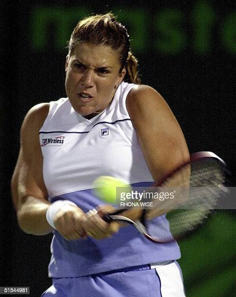 Jennifer Capriati of te US hits a backhand against Chanda Rubin of the US during their third round match 26 March 2000 at the Ericsson Open in Key...